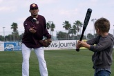 Ryan Gonzalez plays soft toss with 5 year old Dylan